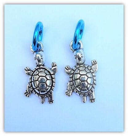 två stickmarkörer sköldpadda med ring